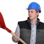 Craftsman holding a shovel — Stock Photo #11072231