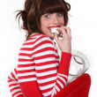 Woman in red eating sweets — Stock Photo