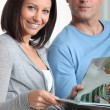Couple at home reading magazines — Stock Photo