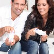 Stock Photo: Couple playing a video game together