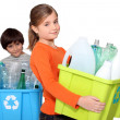 Stock Photo: Children recycling plastic bottles