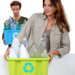 Young couple carrying plastic bottles — Stock Photo