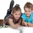 Stock Photo: Brother and sister playing marbles together