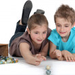 Brother and sister playing marbles together — Stock Photo
