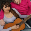 Stock Photo: Couple playing guitar