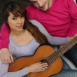 Royalty-Free Stock Photo: Couple playing the guitar