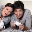 Couple playing video games — Stock fotografie