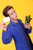 Handyman showing his business card — Stock Photo