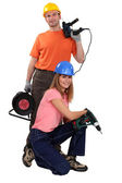 Craftsman and craftswoman working with drills — Stock Photo