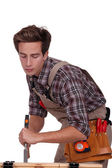 Carpenter with a chisel — Stock Photo