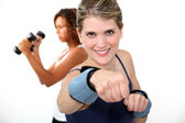 Woman doing exercises with wrist weights — Stock Photo