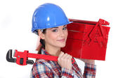 Woman holding wrench and tool box — Stock Photo