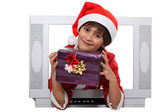 Little boy dressed in Christmas clothes behind a screen — Stock Photo
