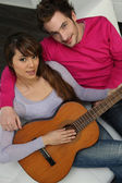 Couple playing the guitar — Stock Photo