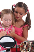 Two young girls playing with jewellery — Stock Photo