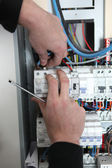 Man at a fuse box — Stock Photo