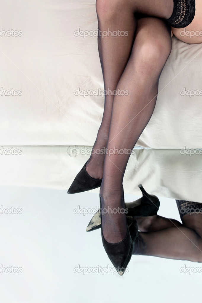 Lady's legs in stockings and heels — Stock Photo #11071793