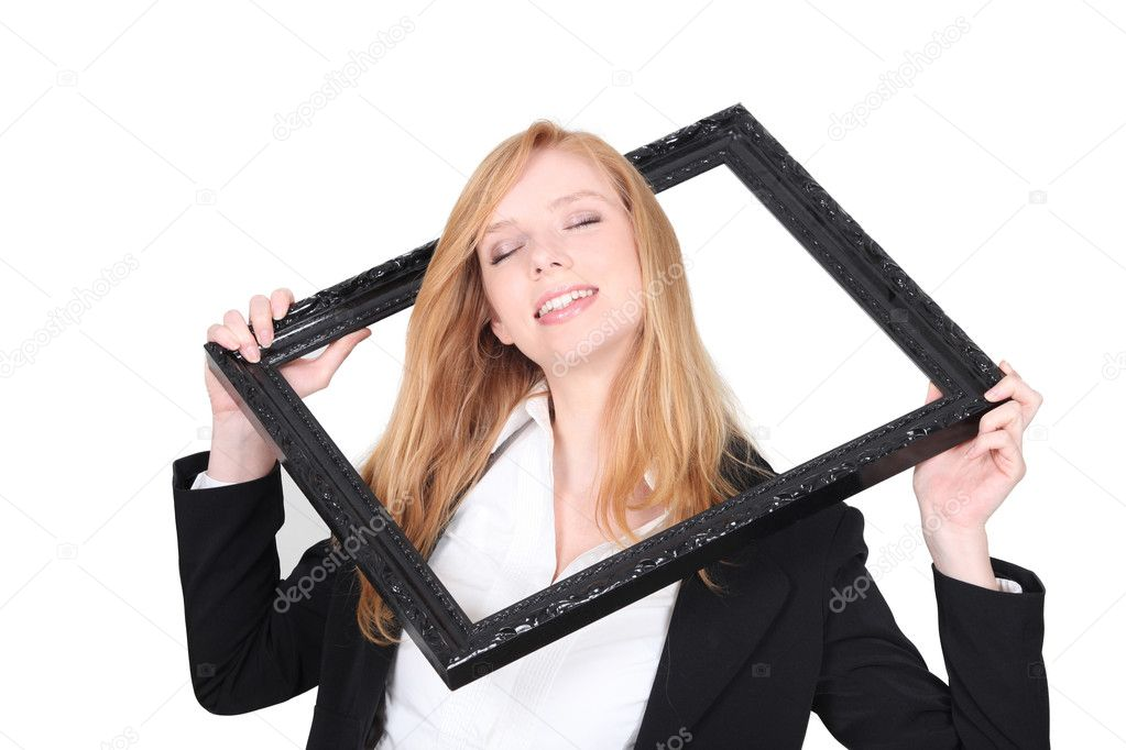 Pretty woman putting her head through a picture frame — Stock Photo #11073969