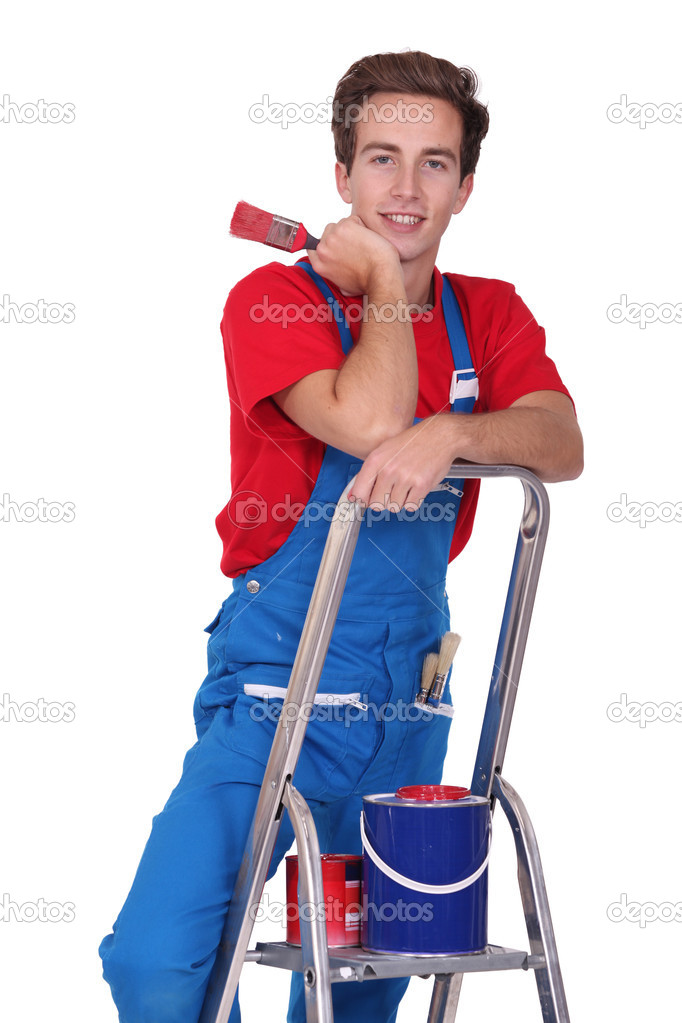 Young man with tin of red painting and brush — Stock Photo #11074079