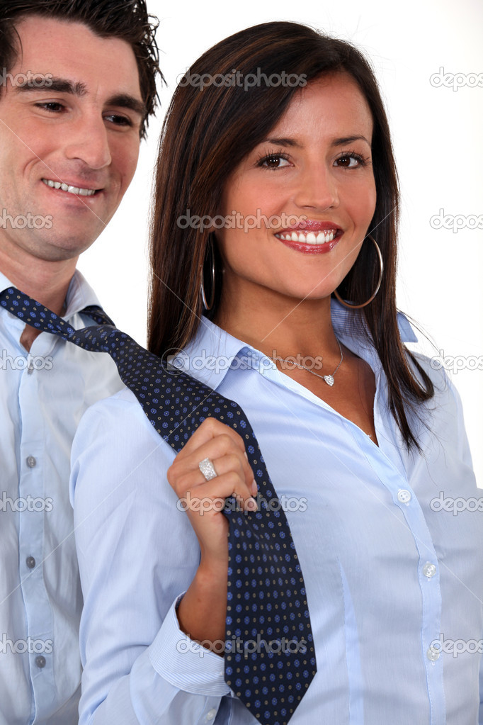 A businesswoman pulling her colleague by the tie. — Stock Photo #11075031