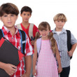 Stock Photo: Schoolchildren with backpacks