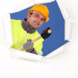 Construction worker with a mallet - Stock Photo
