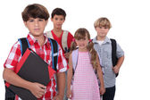 Schoolchildren with backpacks — Stock Photo