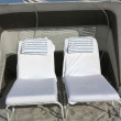 Stock Photo: Sunloungers on beach