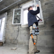 Man fitting double glazing — Stok fotoğraf #11360486