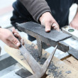 Roofers cutting slate to size — Stock Photo #11360523
