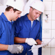 Stock Photo: Plumbers teamworking