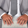 Royalty-Free Stock Photo: Hands of a businessman on a keyboard