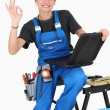 Female plumber giving it the OK — Stock Photo