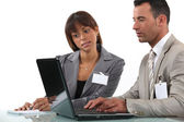 Two business visitors working with laptop — Stock Photo