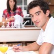 Woman and man in the kitchen — Stock Photo #11464975