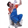 Construction worker in a trolley with a megaphone — Stock Photo