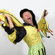 Man in a jester costume playing the fool — Stock Photo