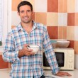 Man with bowl — Stock Photo #11465619