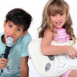 Two young children making music — Stock Photo #11467152