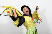 Man in a jester costume playing the fool — Stockfoto