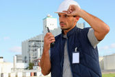 Foreman with radio receiver — Stock Photo