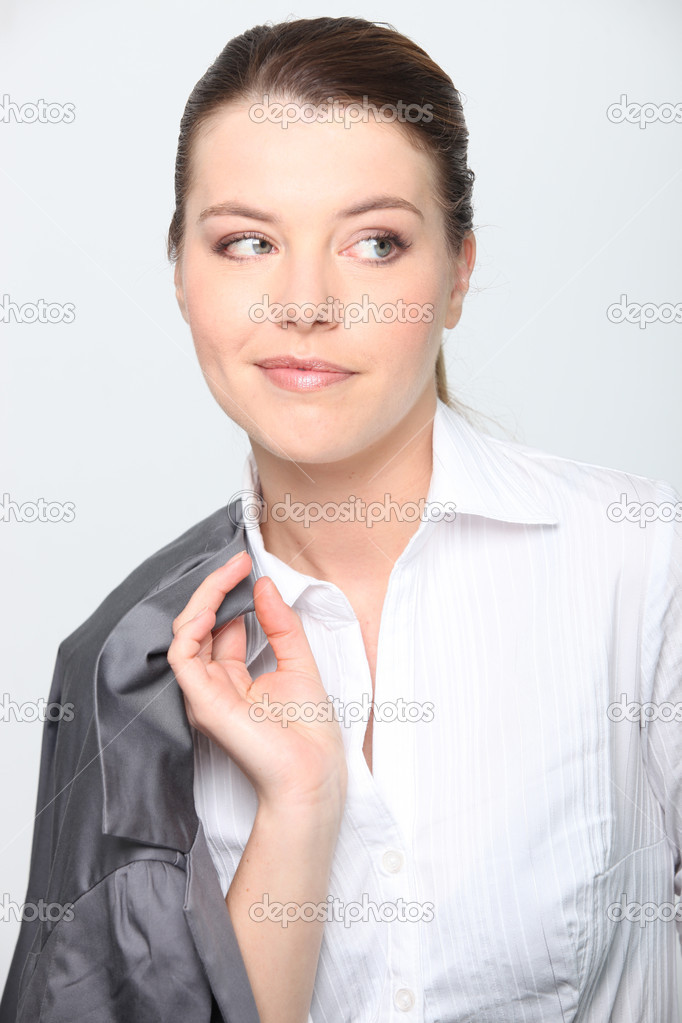 Businesswoman with jacket over shoulder — Stock Photo #11467319