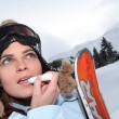 Female snowboarder — Stock Photo #11485392