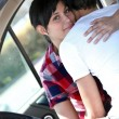 Embracing couple in a car — Stock Photo