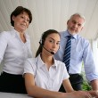 Business at a laptop with headset — Stock Photo #11489478