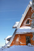 Chalet partly hidden by snow — Stock Photo