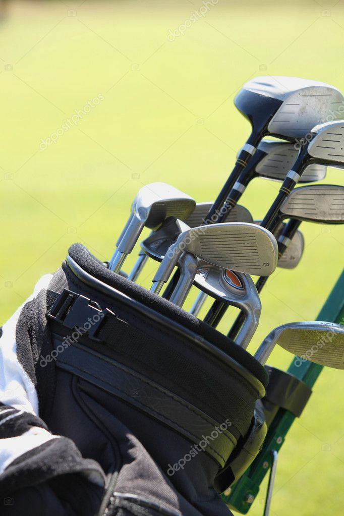 Close up of gold bag and clubs — Stock Photo #11485561