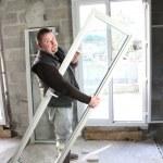 Laborer laying window — Stock Photo #11493236