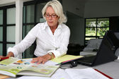 Smart senior businesswoman — Stock Photo