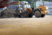 Digger on a work site — Stock Photo
